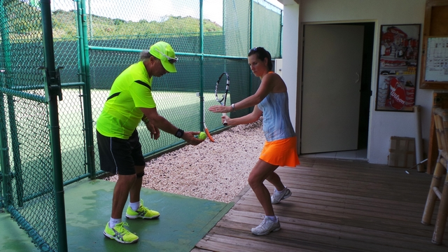 student practices forehand without the ball