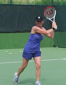 student is demonstrating the perfect forehand motion
